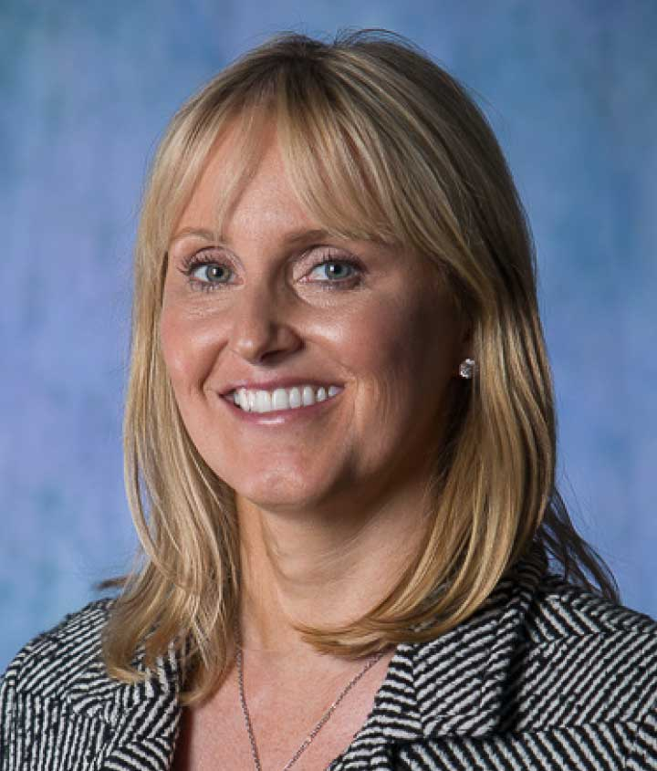 Professional image of Melinda White, The Michael Fuller Group's Director, on a blue background.